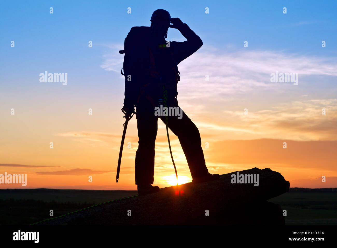 Silhouette scalatore Immagini Stock