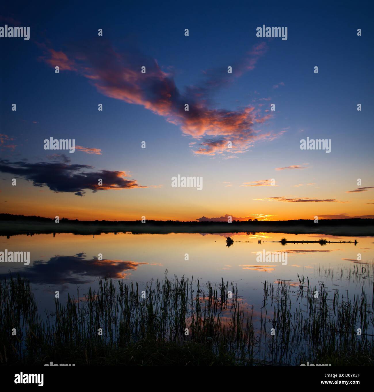 Tramonto sul lago Foto Stock