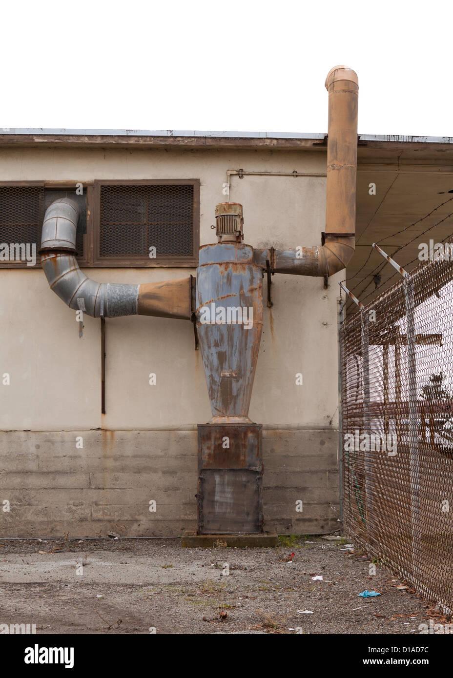 Humanoid edificio a forma di tubo di scarico Immagini Stock