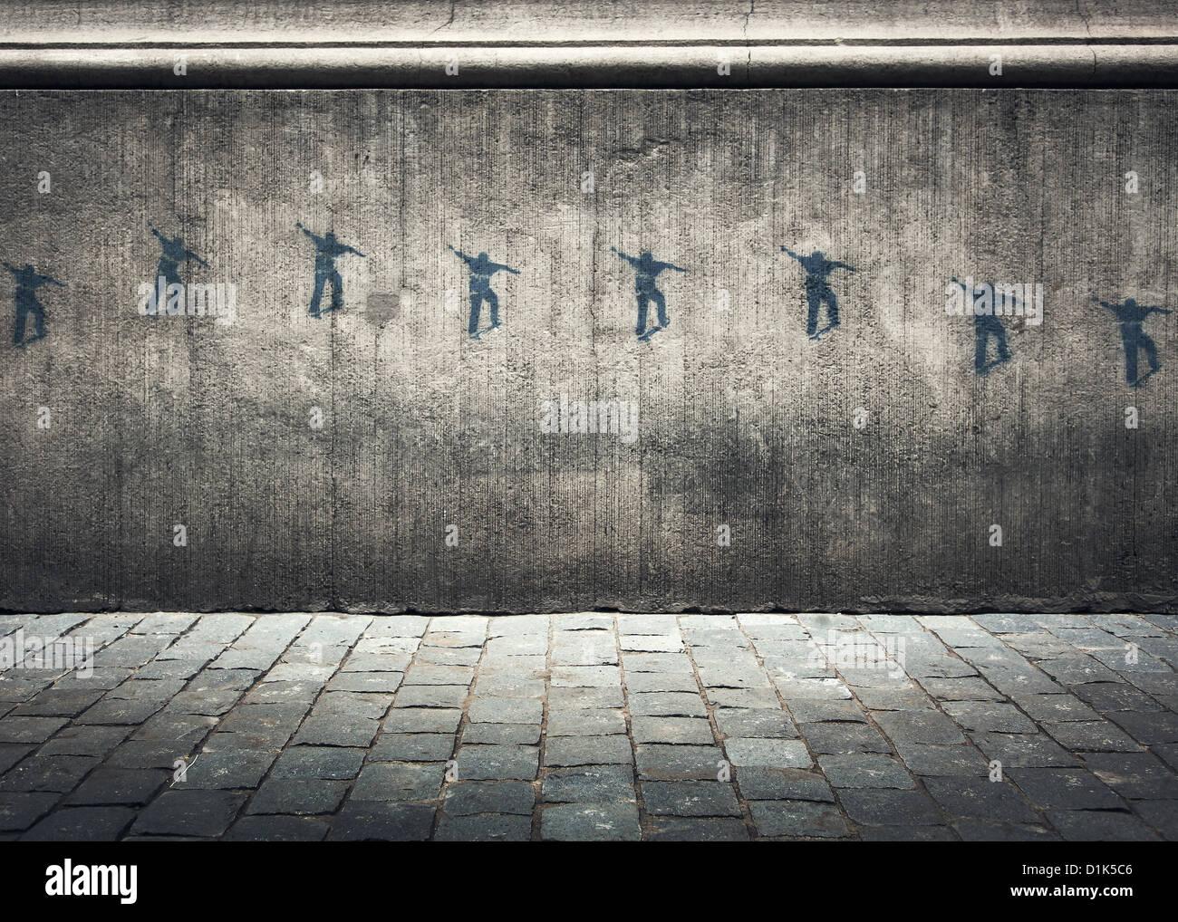 Serie di graffiti su un muro di cemento di un guidatore di skateboard in movimento attraverso l'aria. Immagini Stock