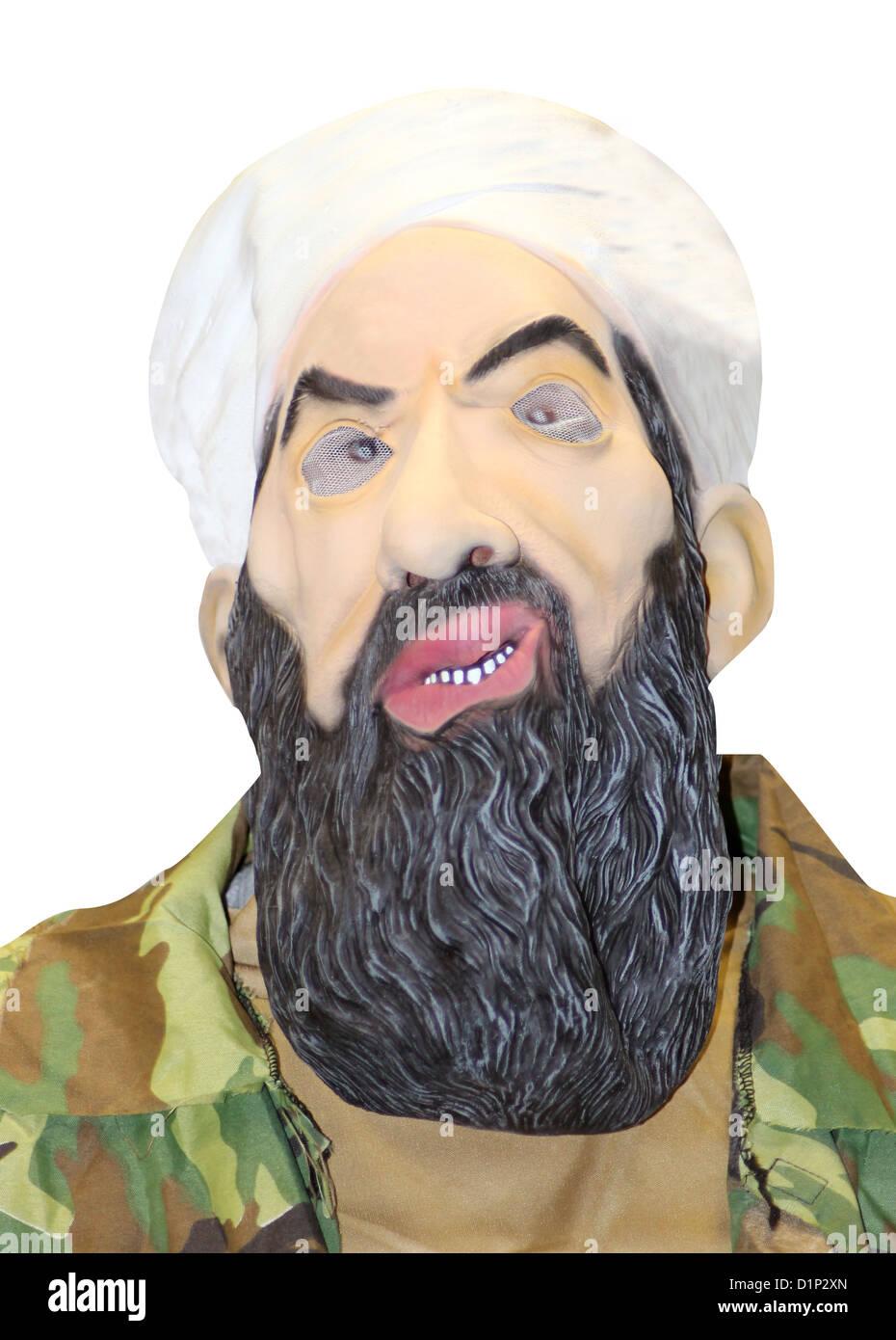 Ritratto di persona nella maschera di Osama Bin Laden, bianco di sfondo per studio. Immagini Stock