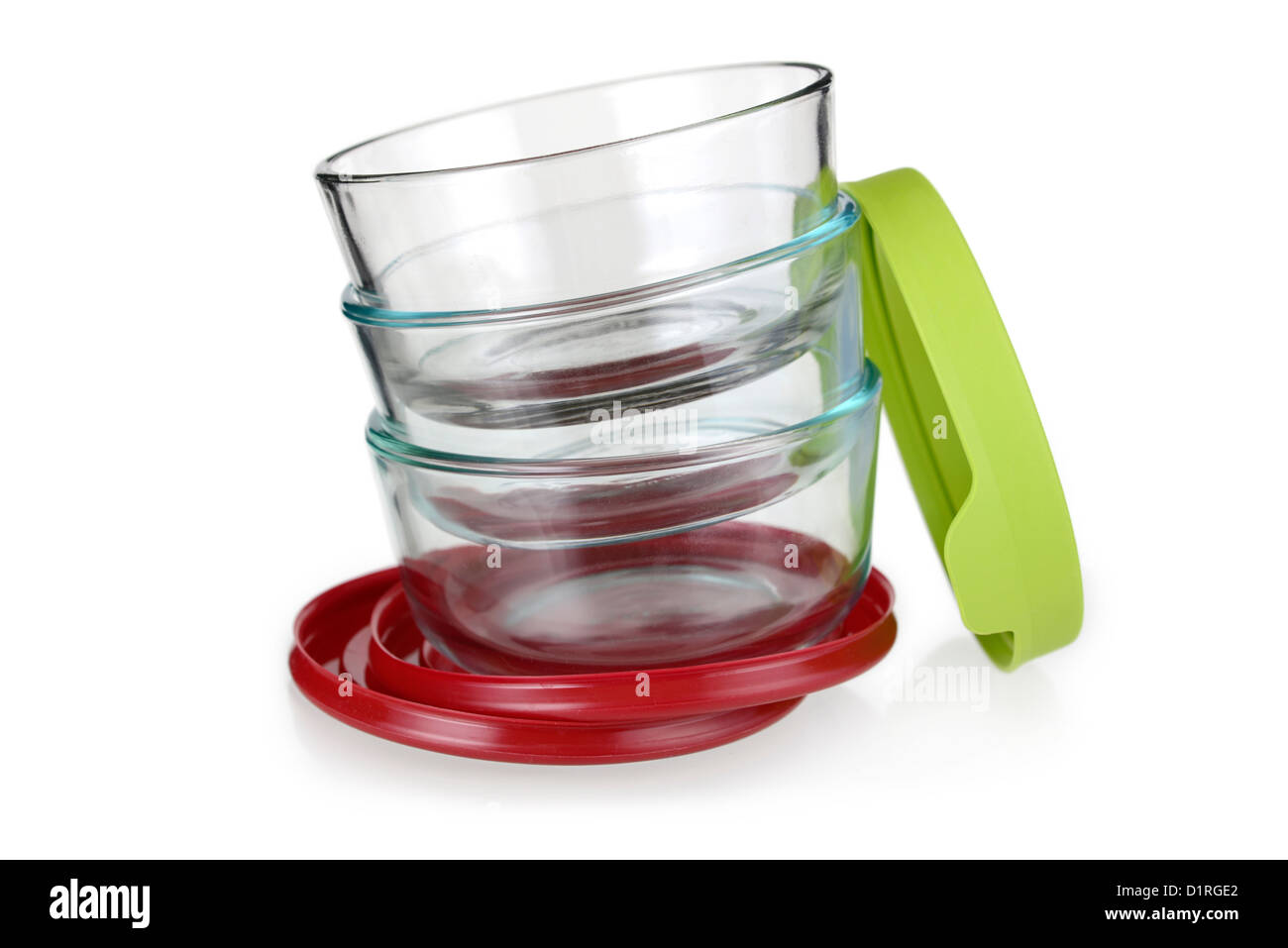 Contenitori per alimenti, ciotole in vetro con coperchi in plastica Immagini Stock