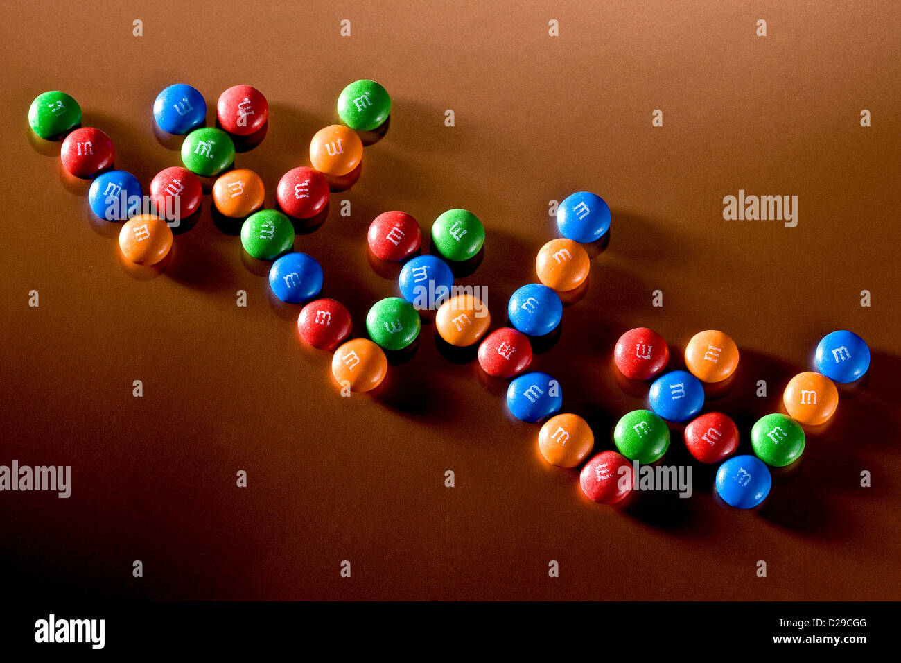 M&M caramelle layout come www Immagini Stock