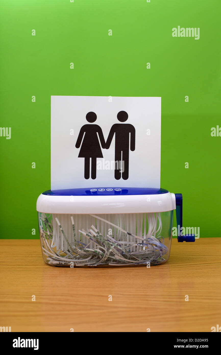 Simboli di genere tenendo le mani, in procinto di essere distrutti Immagini Stock
