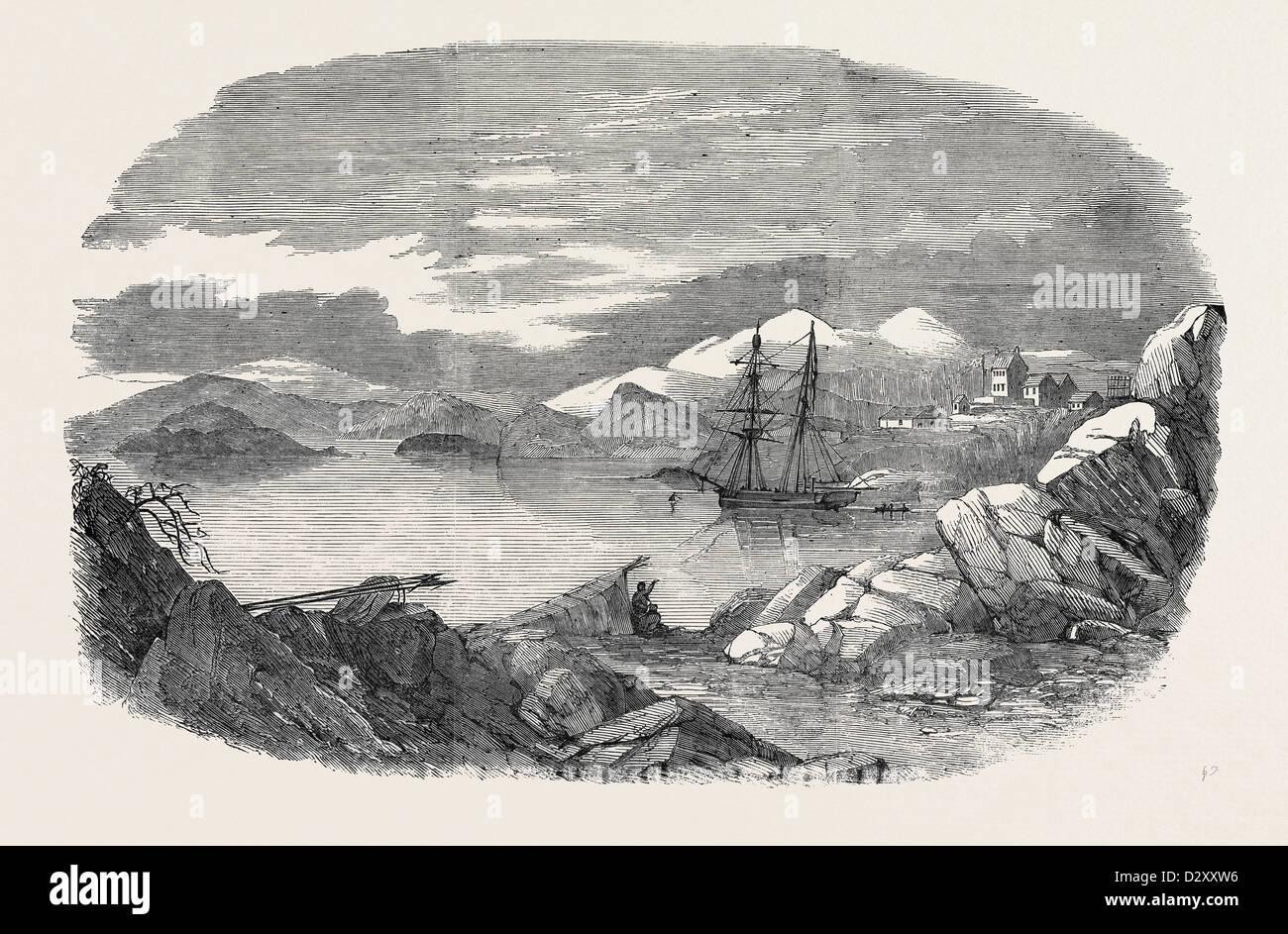 FISKERNOES, un insediamento danese, NEL SUD DELLA GROENLANDIA, con 'l'Isabel' AL DI ANCORAGGIO Immagini Stock