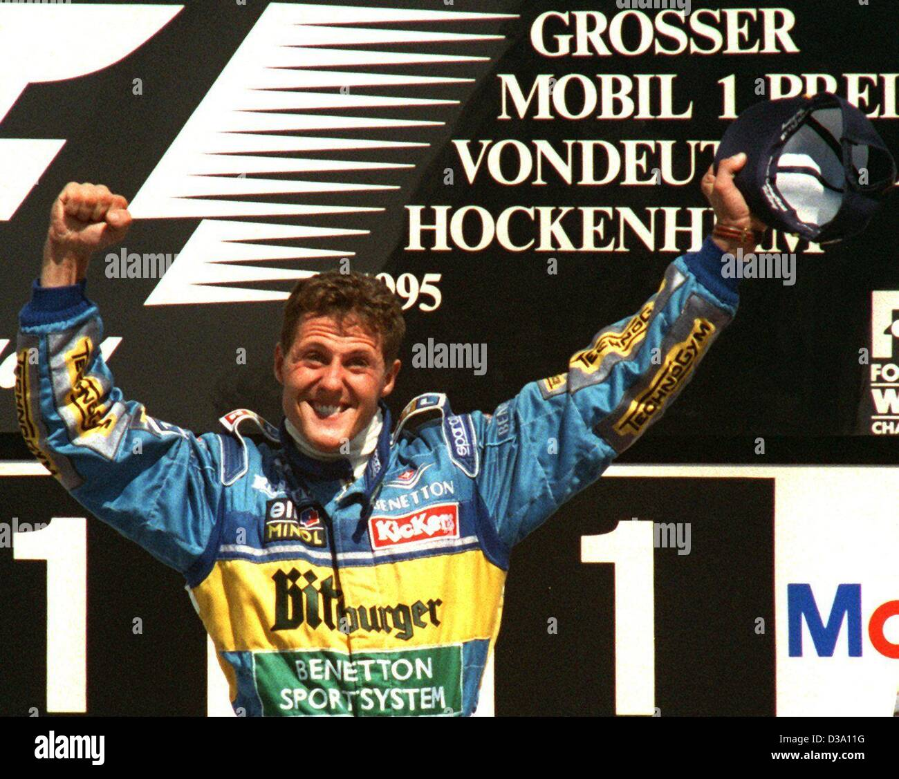 Dpa file) - Michael Schumacher cheers sul podio come egli vince il ...