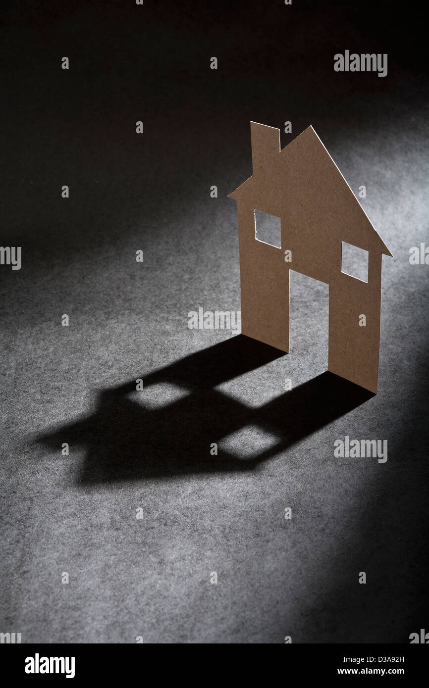 Casa di cartone di forma ombra di colata Immagini Stock