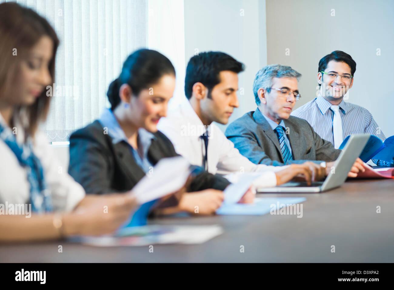 I dirigenti aziendali in una riunione Immagini Stock