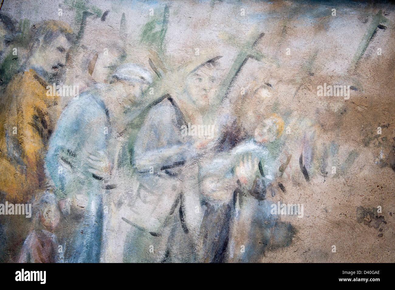 Arte religiosa vede dipinta su una delle molte chiese in Vilnius Lituania. In questa scena persone sono croci e Immagini Stock