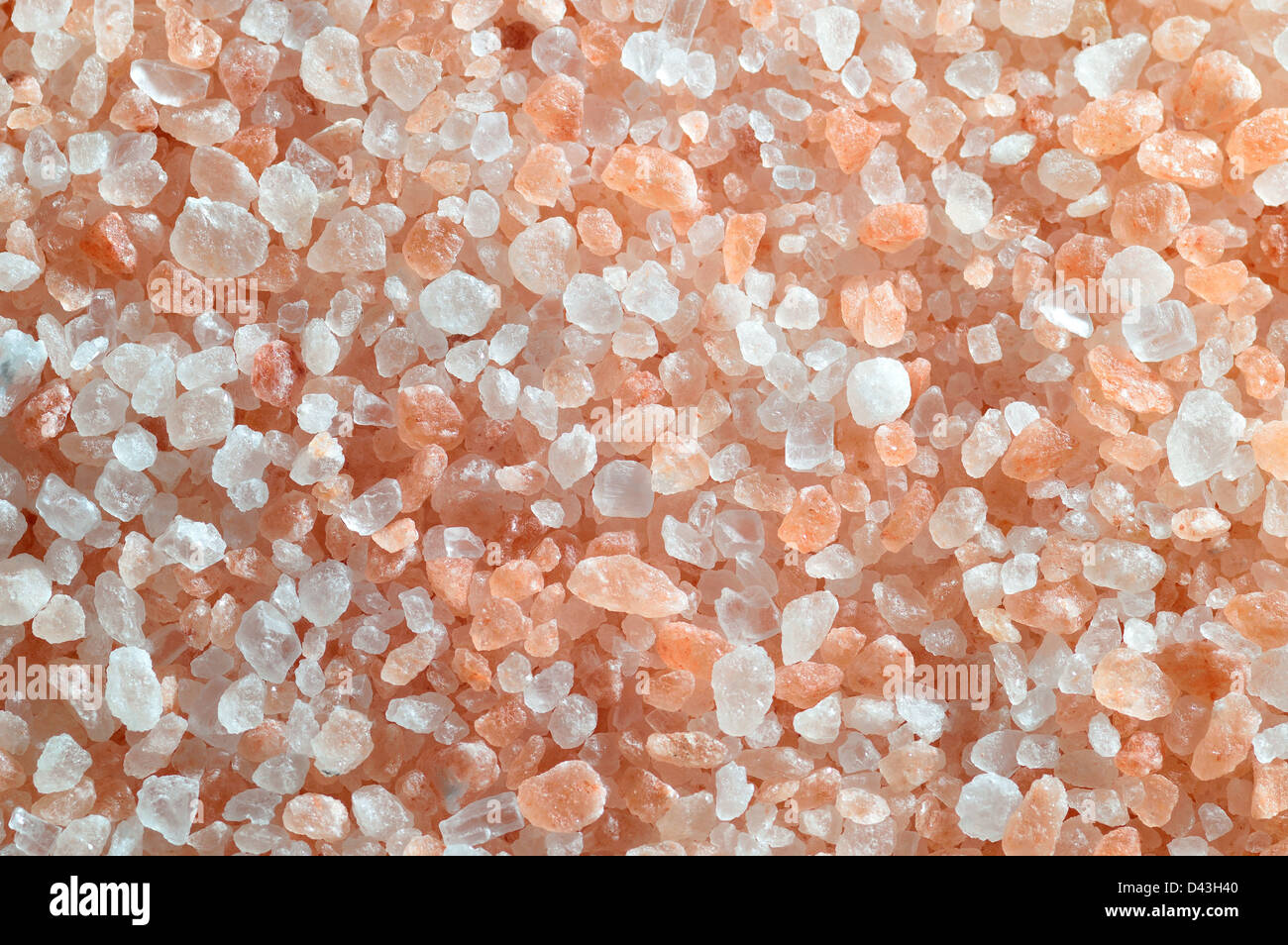 Sale rosa dall'Himalaya - Sfondo. Primo piano dei cristalli di sale. Immagini Stock