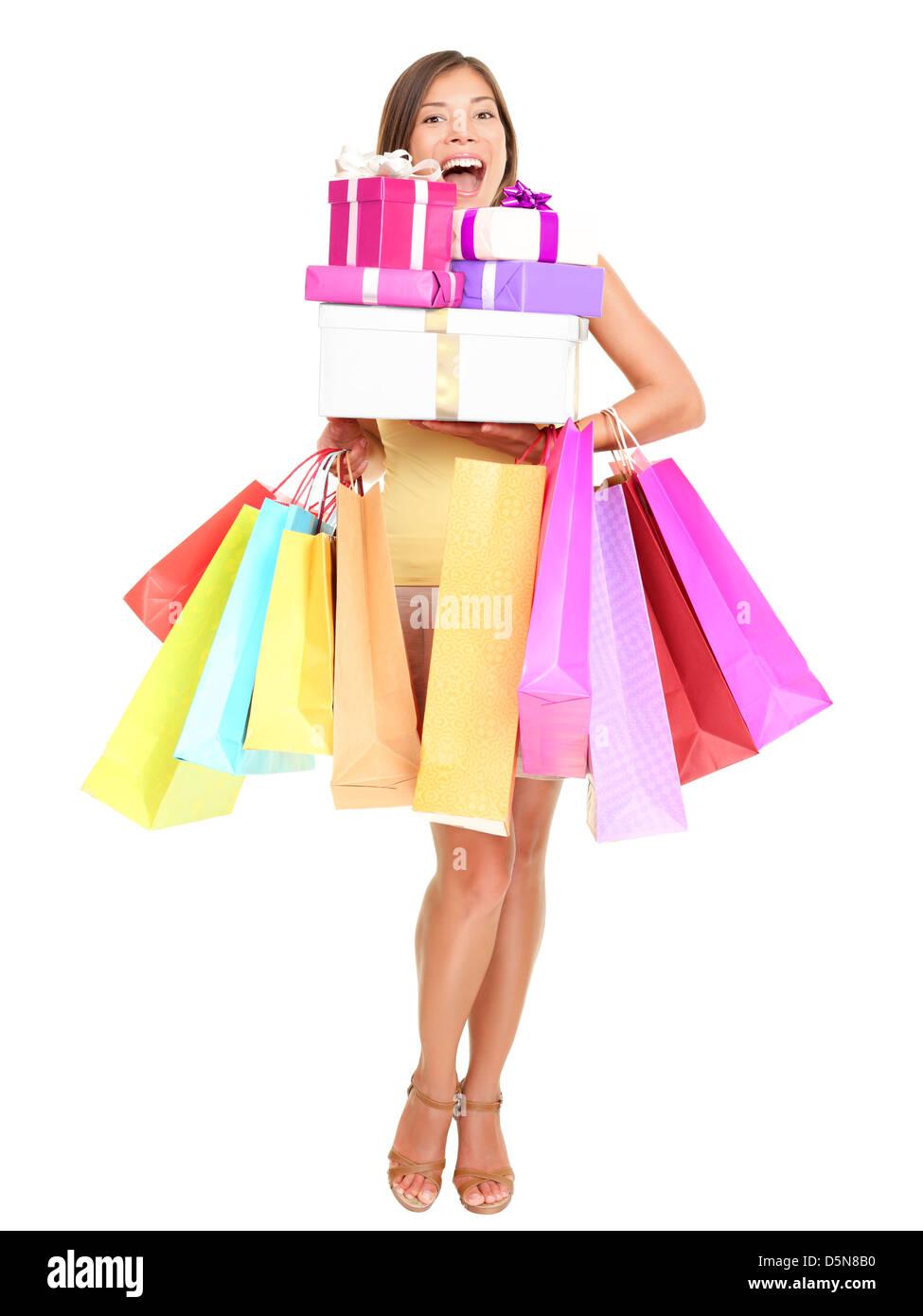 Ritratto di Allegro shopping donna azienda molte borse per