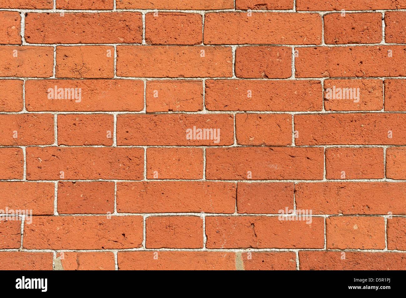 Dettaglio di un muro di mattoni con molto sottili linee di malta Immagini Stock