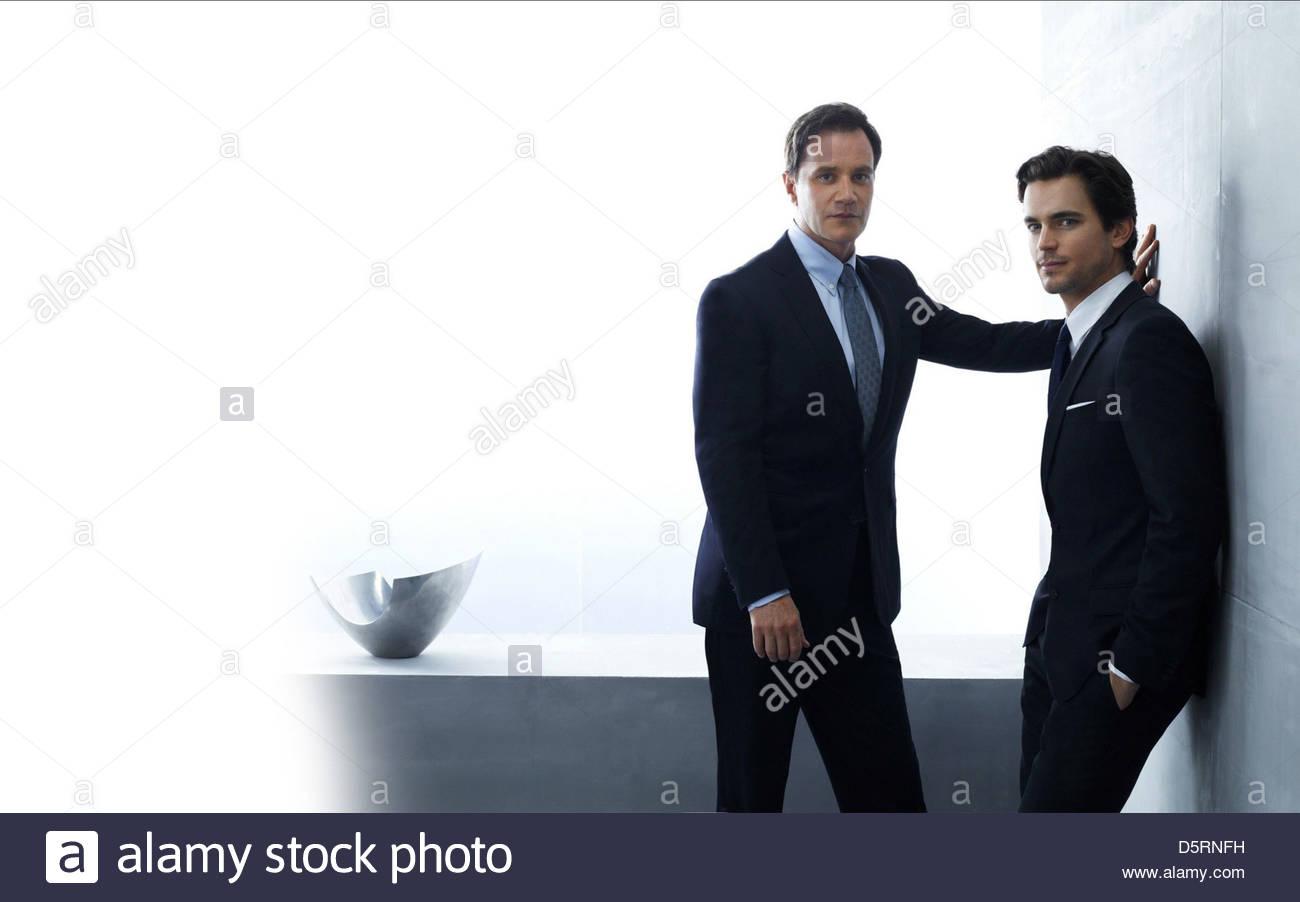 TIM DEKAY & MATT BOMER collare bianco (2009) Immagini Stock