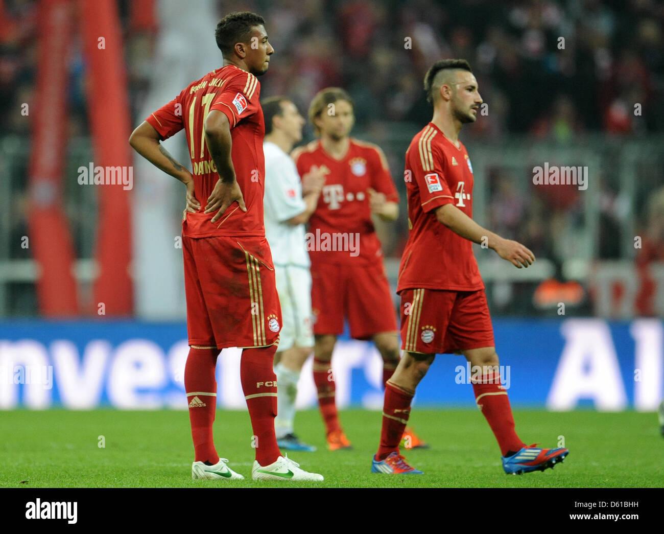 FC Bayern Monaco di Baviera Jerome Boateng (L-R), Anatoli Timoschtschuk e Diego Contento sono deluso dopo la Bundesliga Immagini Stock