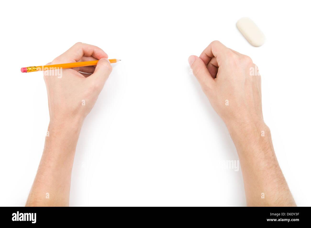 Sinistra-hander con matita a scrivere qualcosa Immagini Stock