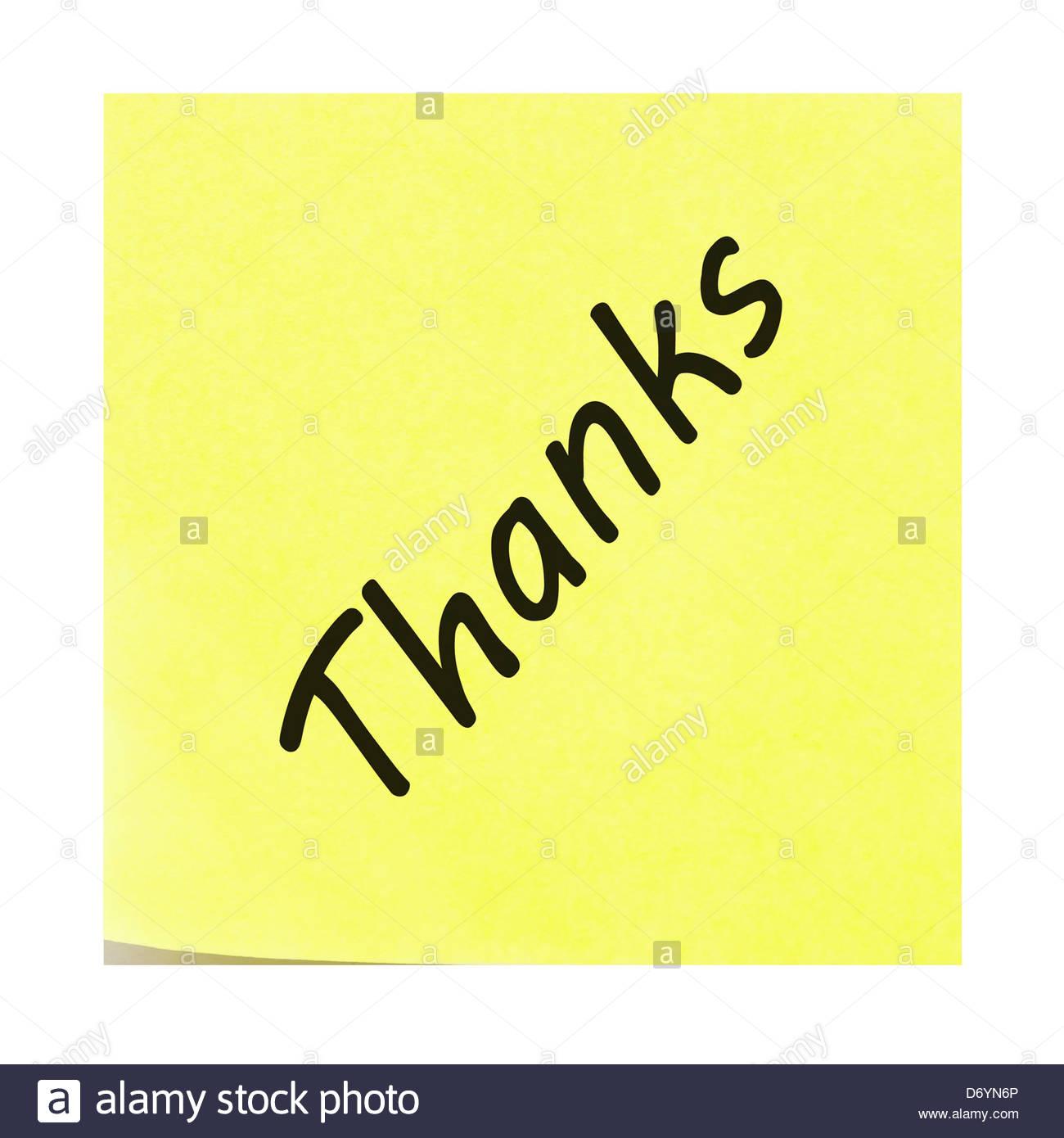 Grazie scritto su un bigliettino giallo. Post-it con il peeling ad angolo verso l'alto. Immagini Stock