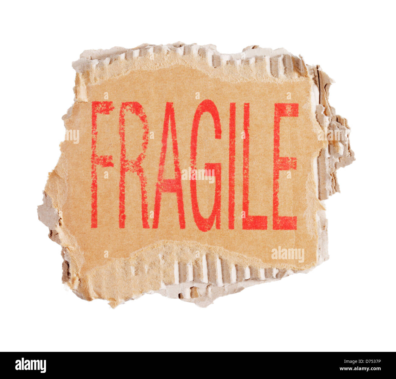 Parola Fragile stampigliato su un pezzo di marrone di cartone ondulato. Immagini Stock