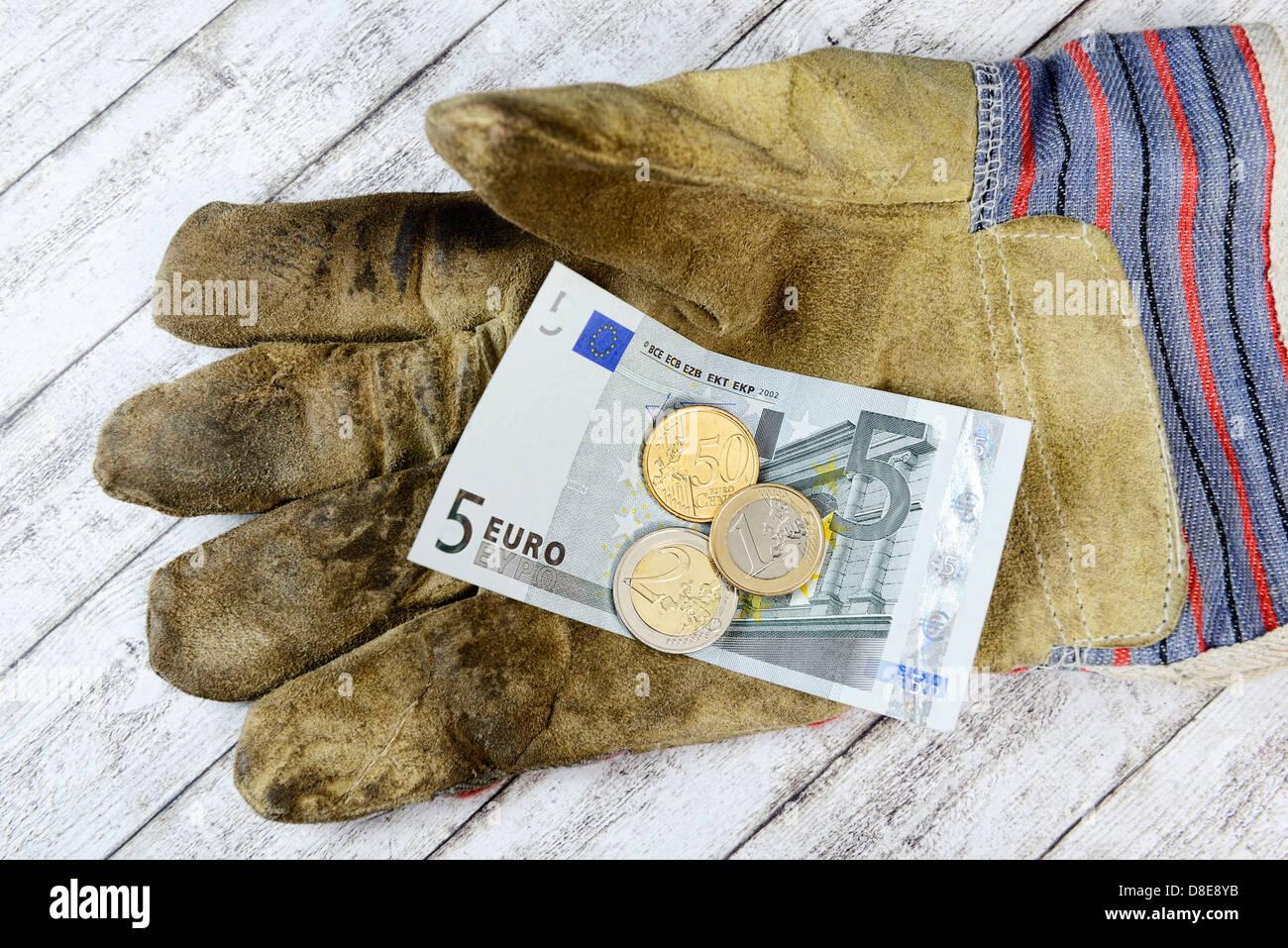 Guanti di lavoro con 8.50 euro salario minimo Immagini Stock