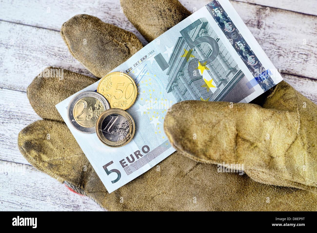 Guanti di lavoro con 8.50 euro salario minimo Foto Stock