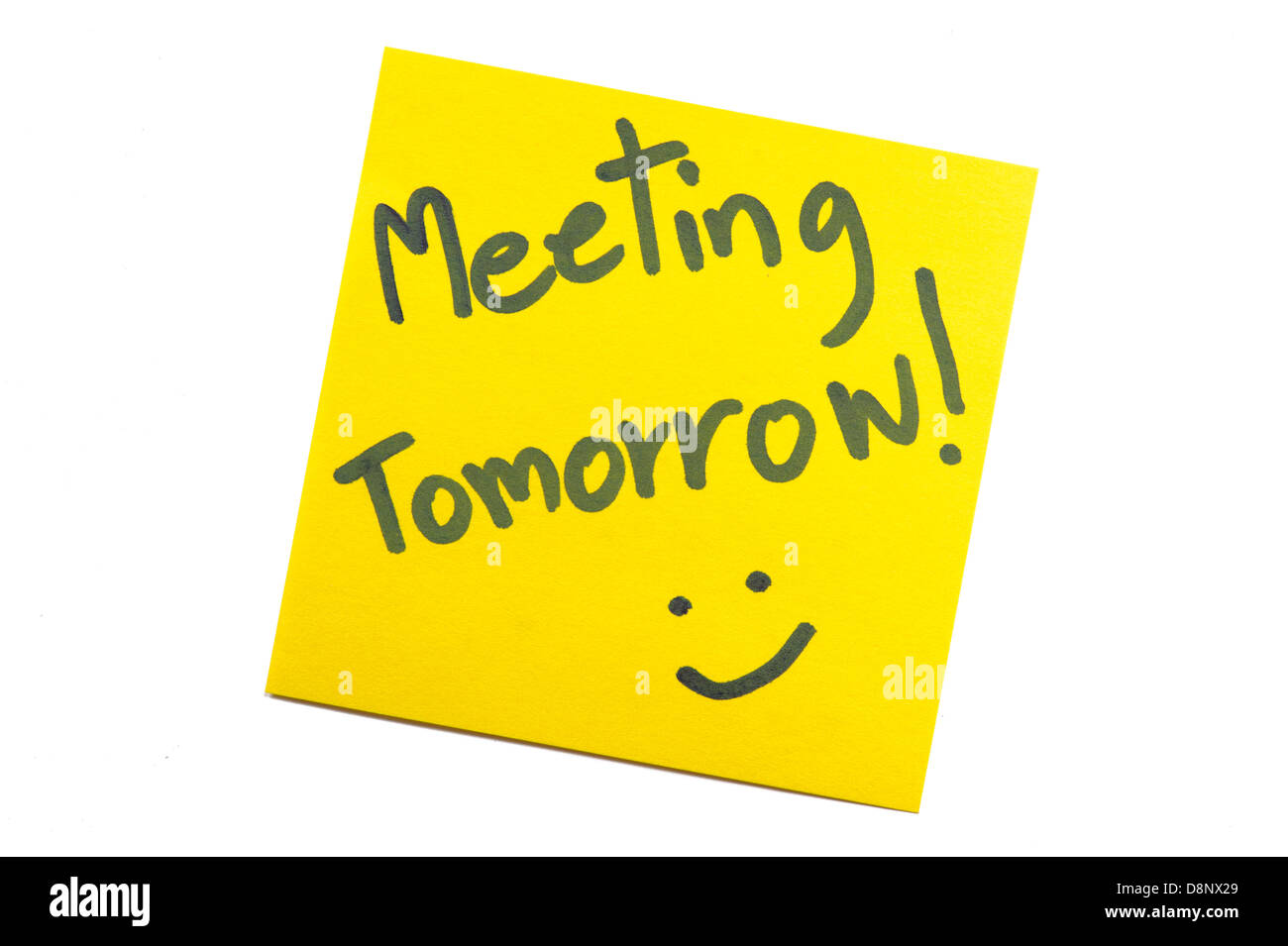 "Nota adesiva con testo 'Meeting domani"" Immagini Stock"
