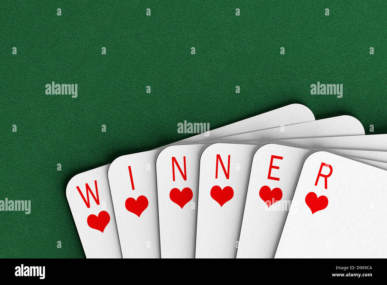 Carte da gioco su un feltro tabella l'ortografia della parola vincitore Foto Stock