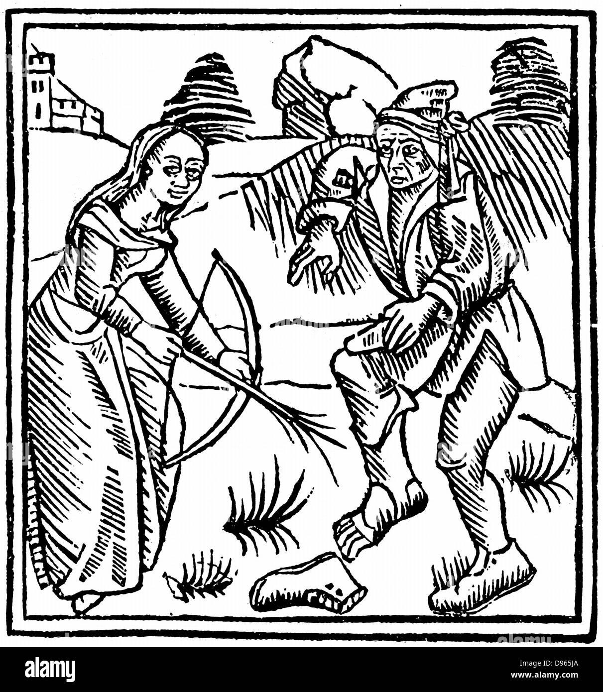 Strega la ripresa di un uomo in piedi con una freccia incantata fatta da una bacchetta di nocciolo. Da Ulrich Molitor Immagini Stock