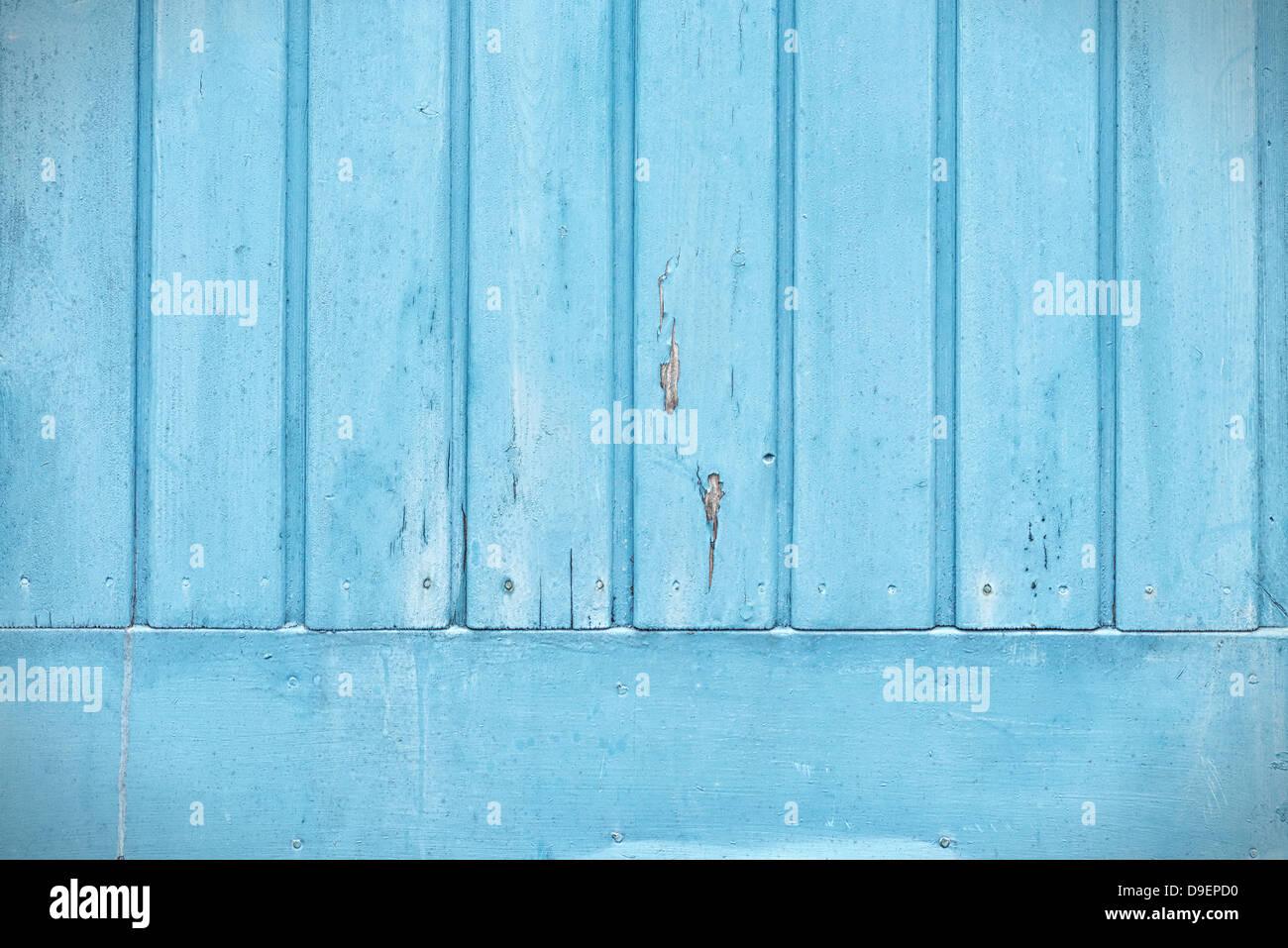Dettaglio del blu del pannello di legno nella parte inferiore di una porta Immagini Stock