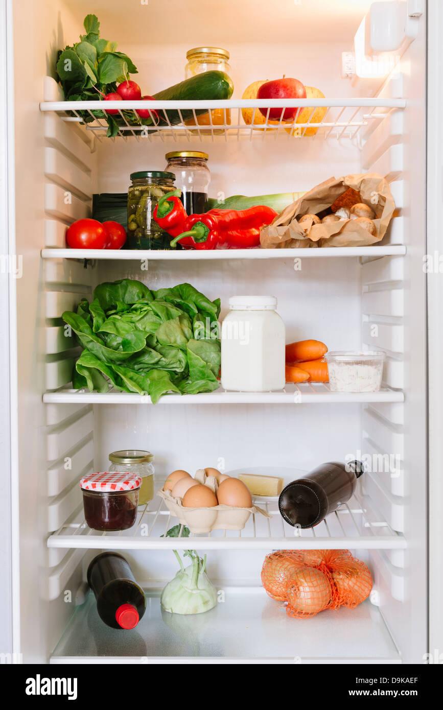Apra il frigorifero Immagini Stock
