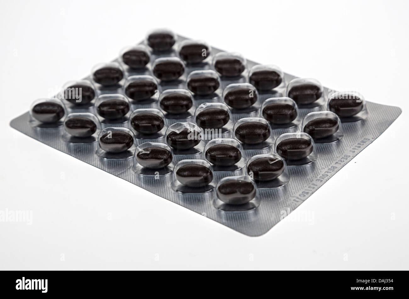 Coenzima Q10 antiossidante compresse in blister Immagini Stock