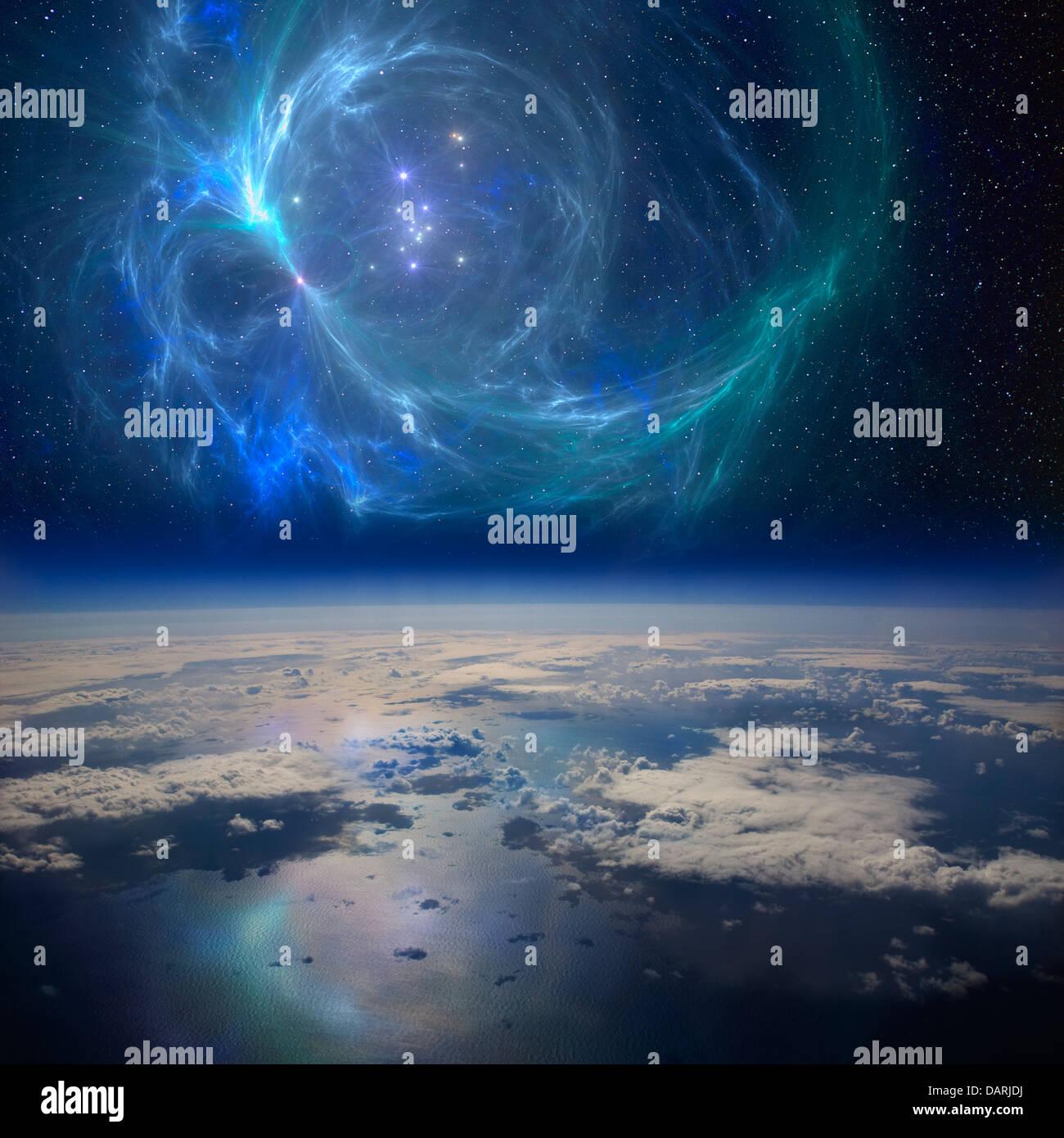 La messa a terra nei pressi di una bella nebulosa nello spazio. Un composito concettuale dell'immagine. Immagini Stock