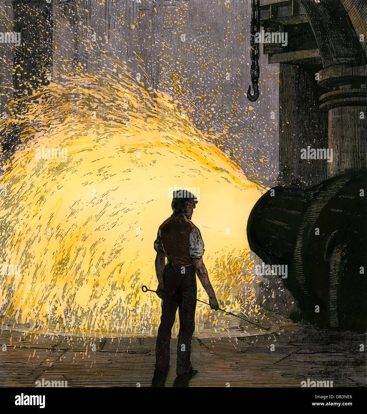 Acciaio-mill lavoratore supervisionare un acciaio Bessemer convertitore, 1800s. Colorate a mano la xilografia Immagini Stock