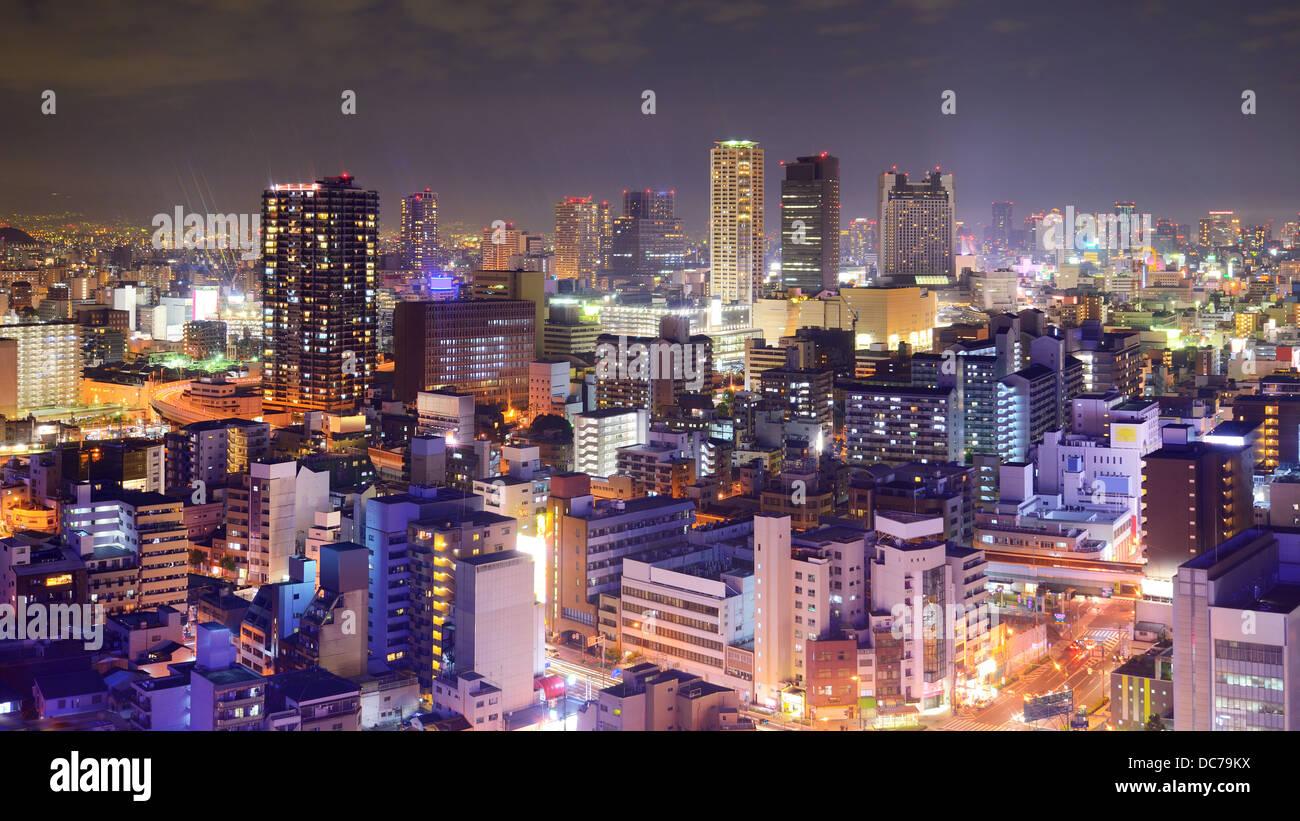 Osaka, Giappone skyline notturno. Immagini Stock