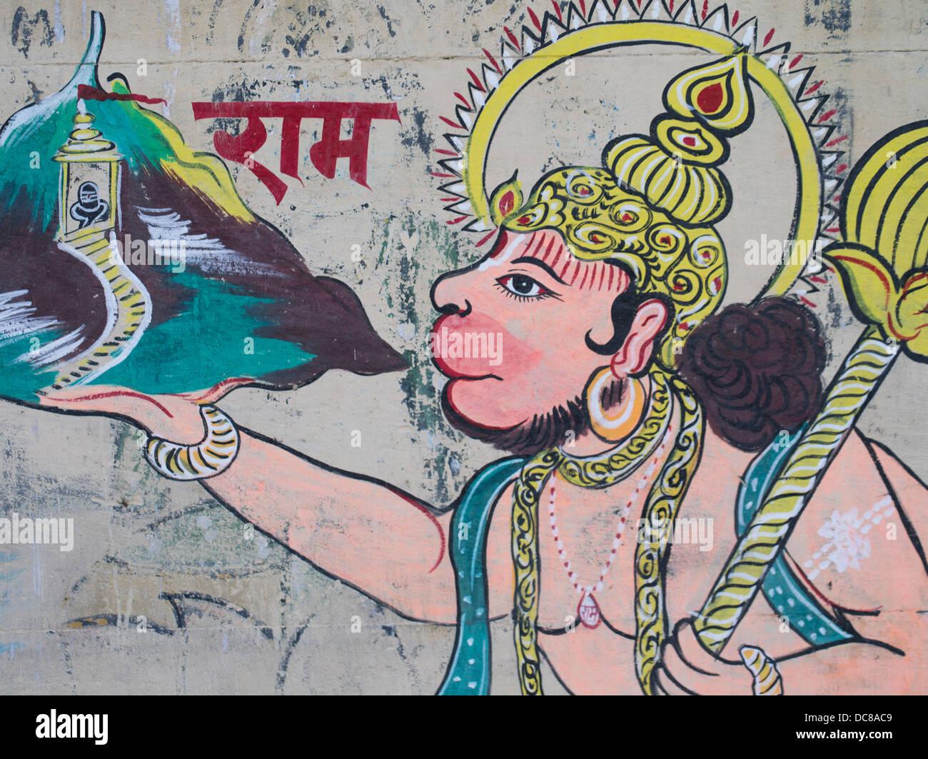 Hanuman, divinità Indù, murale su edifici situati sulle rive del Gange Fiume - Varanasi, Uttar Pradesh, Immagini Stock