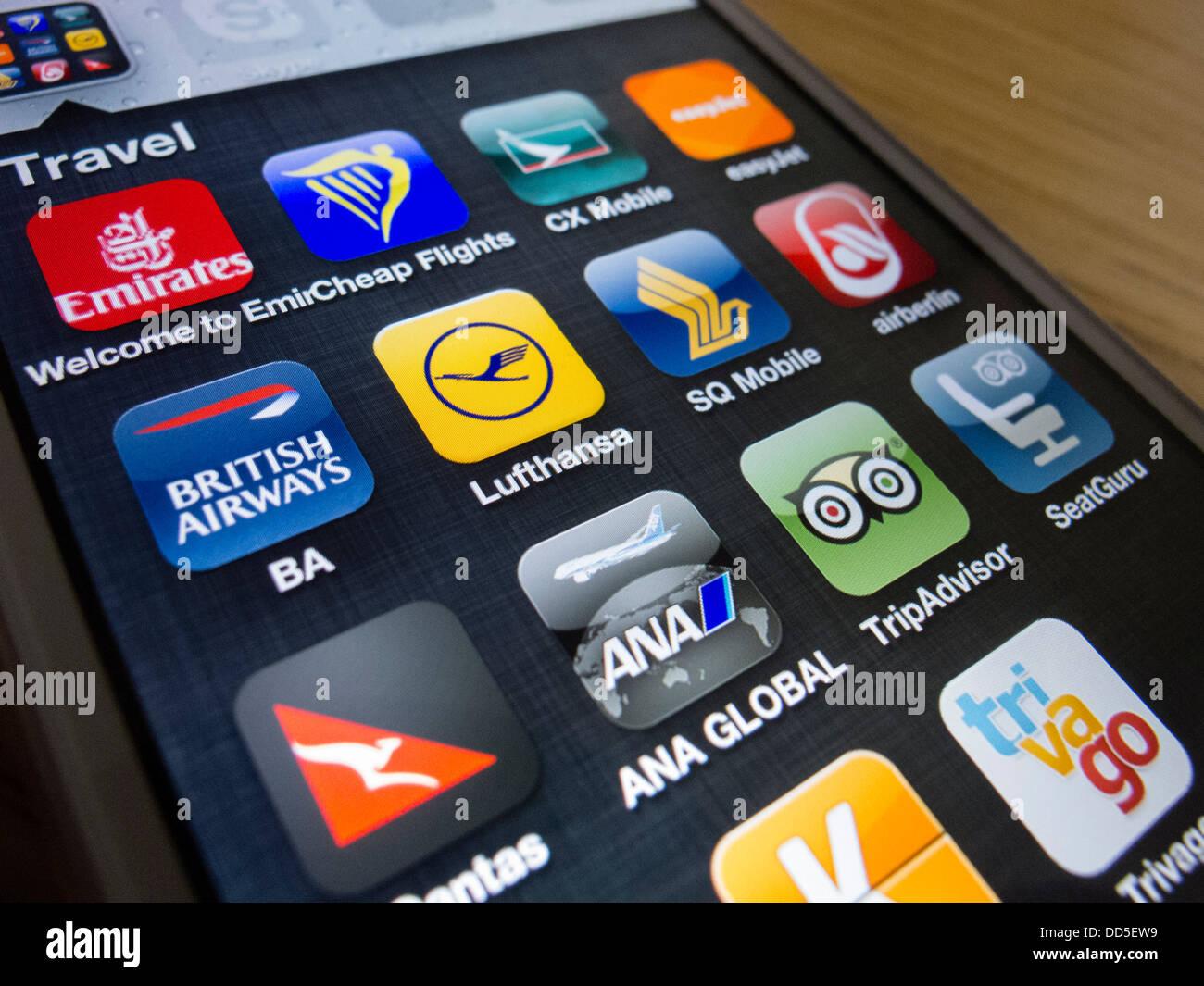 Dettaglio di molti viaggi e compagnia aerea app su un iPhone 5 smart phone Immagini Stock