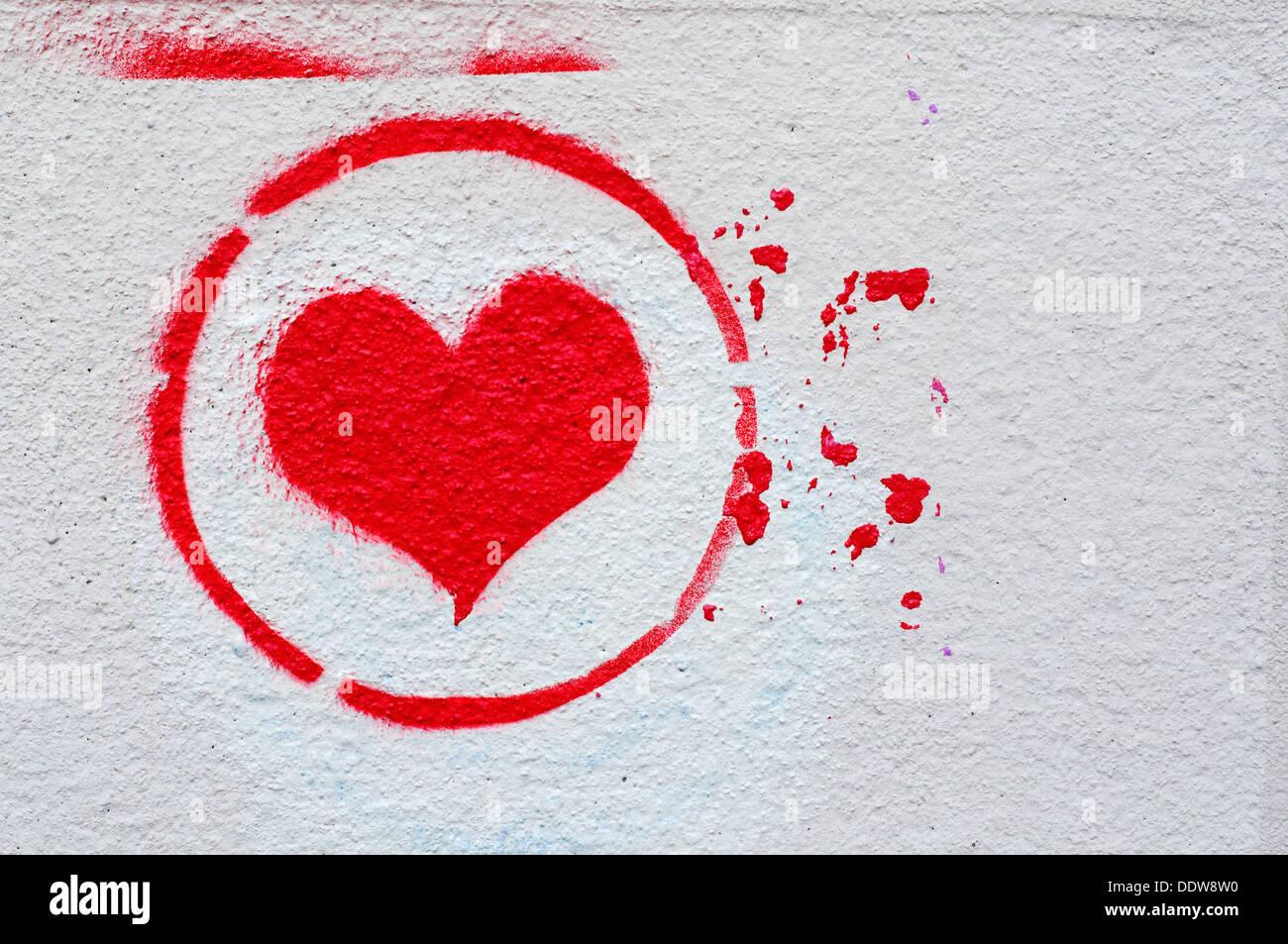 Cuore Graffiti spruzzato su una parete Immagini Stock
