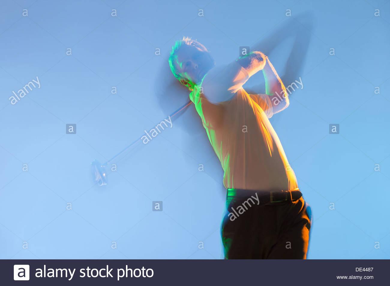 Vista offuscata del giocatore di golf club oscillante Immagini Stock