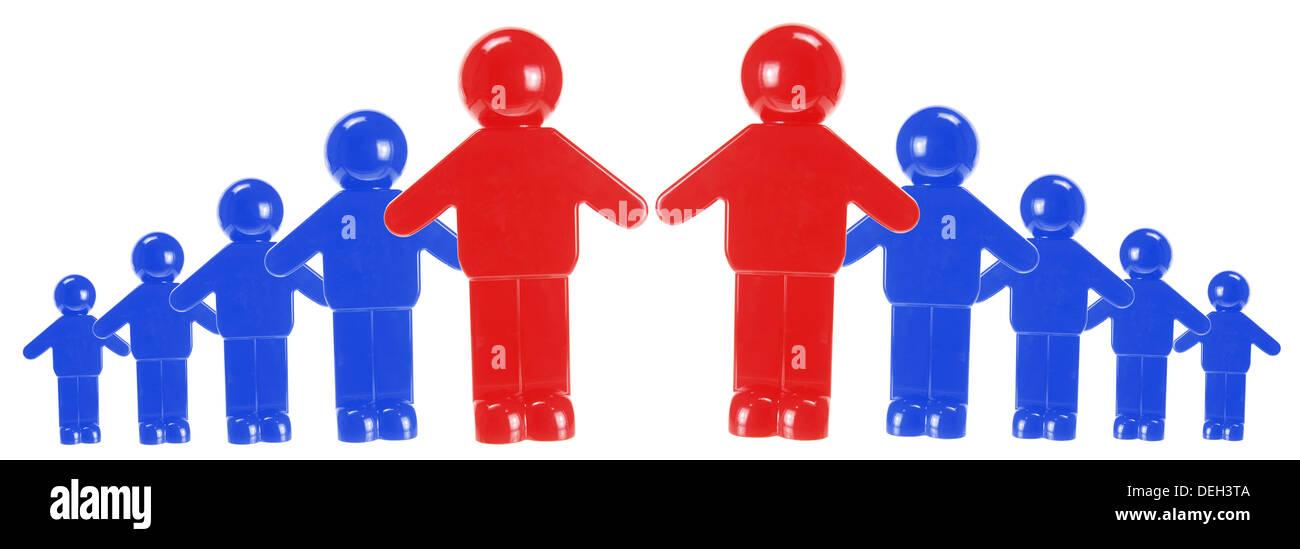 Concetto di lavoro di squadra con figure in miniatura Immagini Stock
