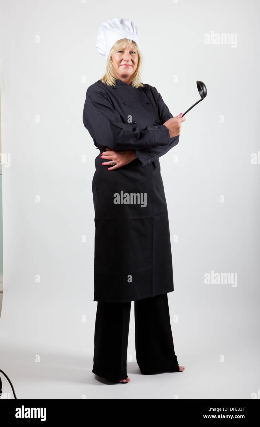 Lo chef femmina contro uno sfondo bianco Immagini Stock