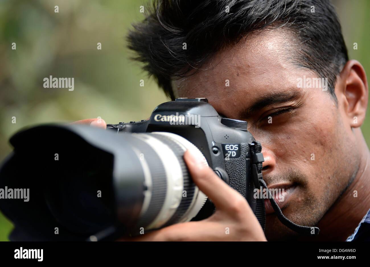 Fotografo professionista,Wildlife Photographer,fotocamera,lente,riprese,giovane adulto,studente,l'India Immagini Stock