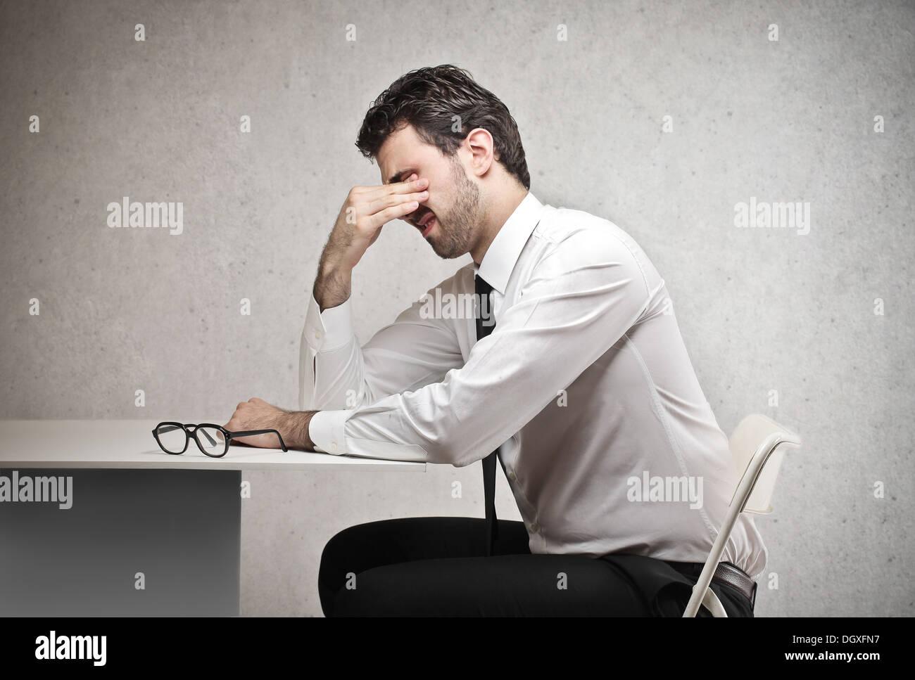 Sottolineato lavoratore di ufficio Immagini Stock