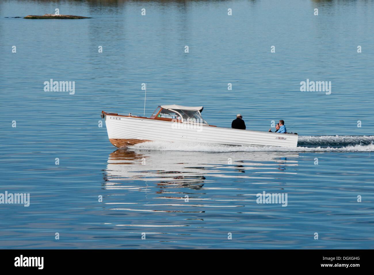 New York, San Lawrence Seaway, migliaia di isole. Vintage ricreativo con una barca a motore lungo la seaway. Immagini Stock