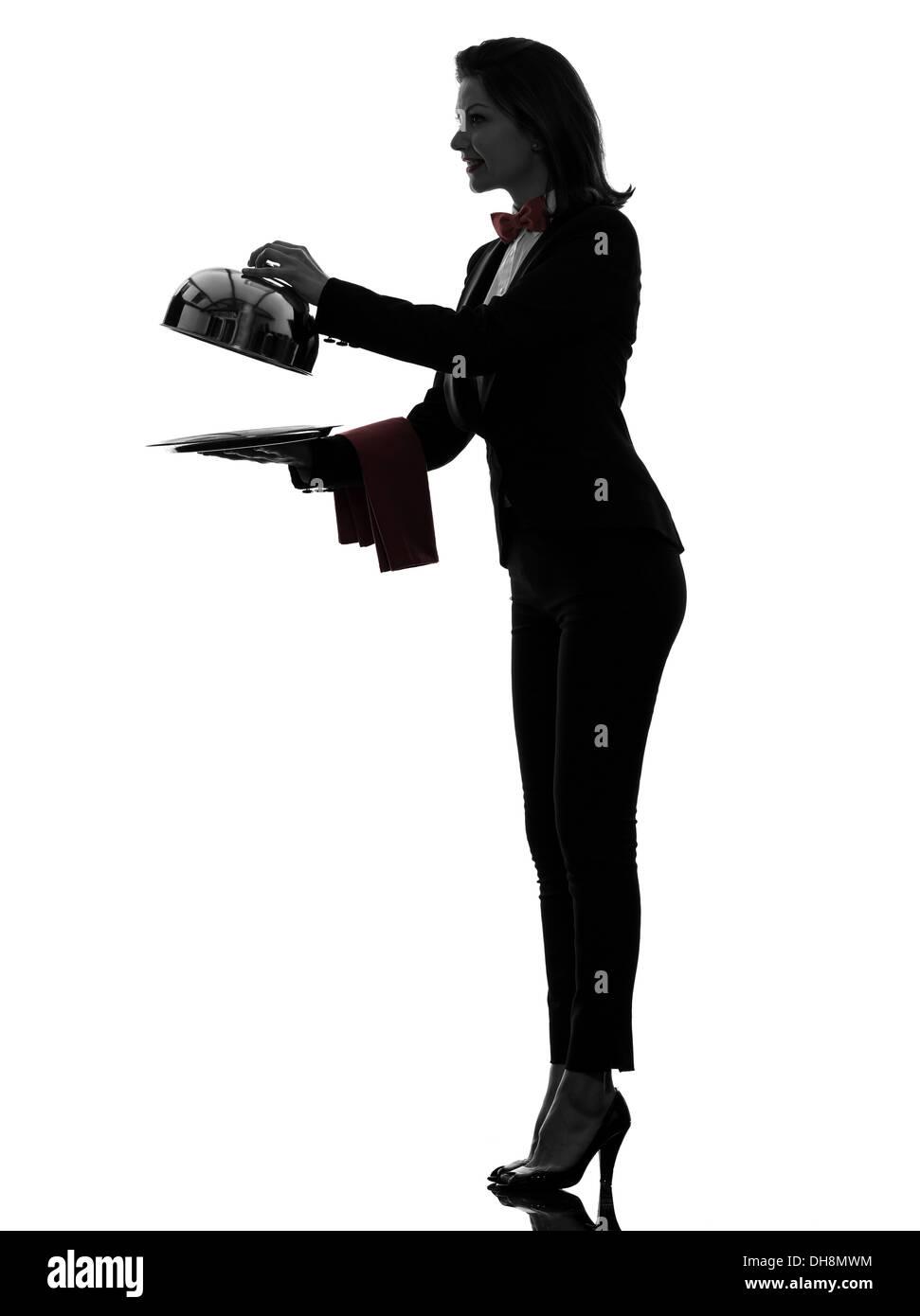 Una donna cameriere maggiordomo Ristorazione apertura cupola in silhouette su sfondo bianco Immagini Stock