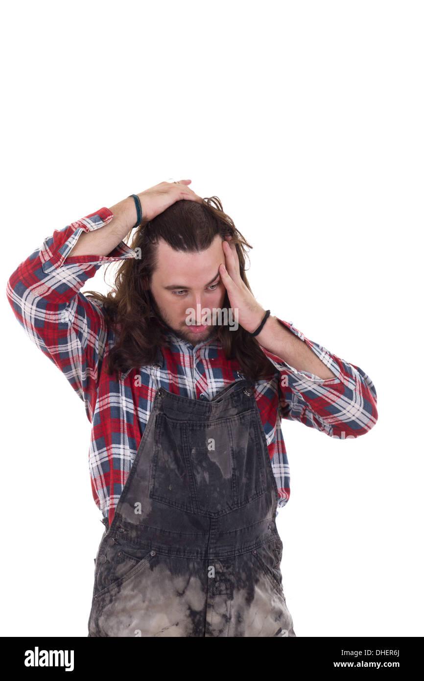 Lavoratore edile è interessato a causa della perdita del posto di lavoro Immagini Stock