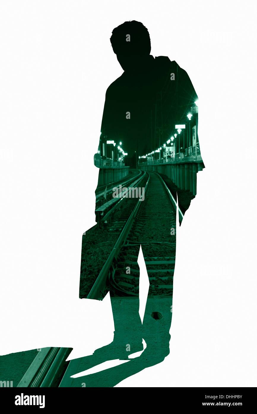 Tagliare silhouette di un imprenditore con scena urbana Immagini Stock