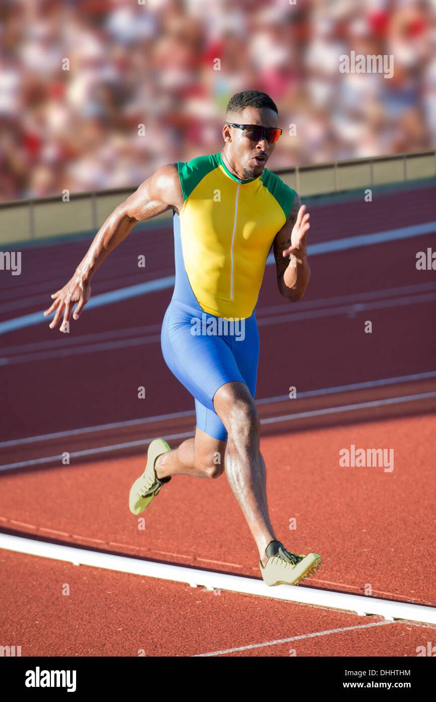 Runner racing su pista Immagini Stock