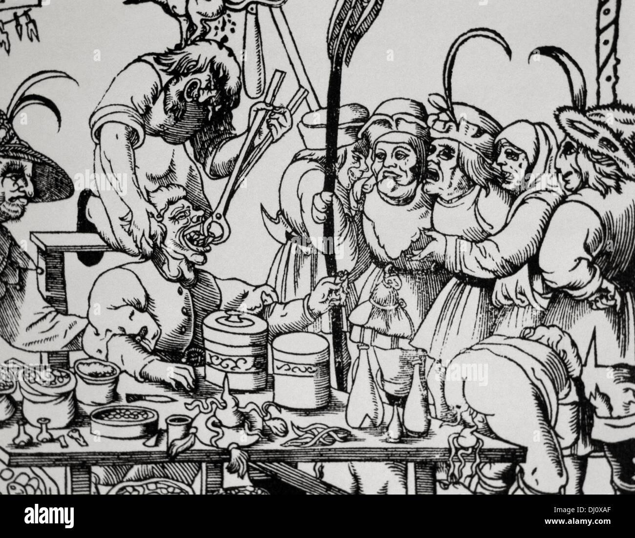 La storia della medicina. Dentista (barbieri o medici generali). Medioevo. La satira. Incisione. Immagini Stock