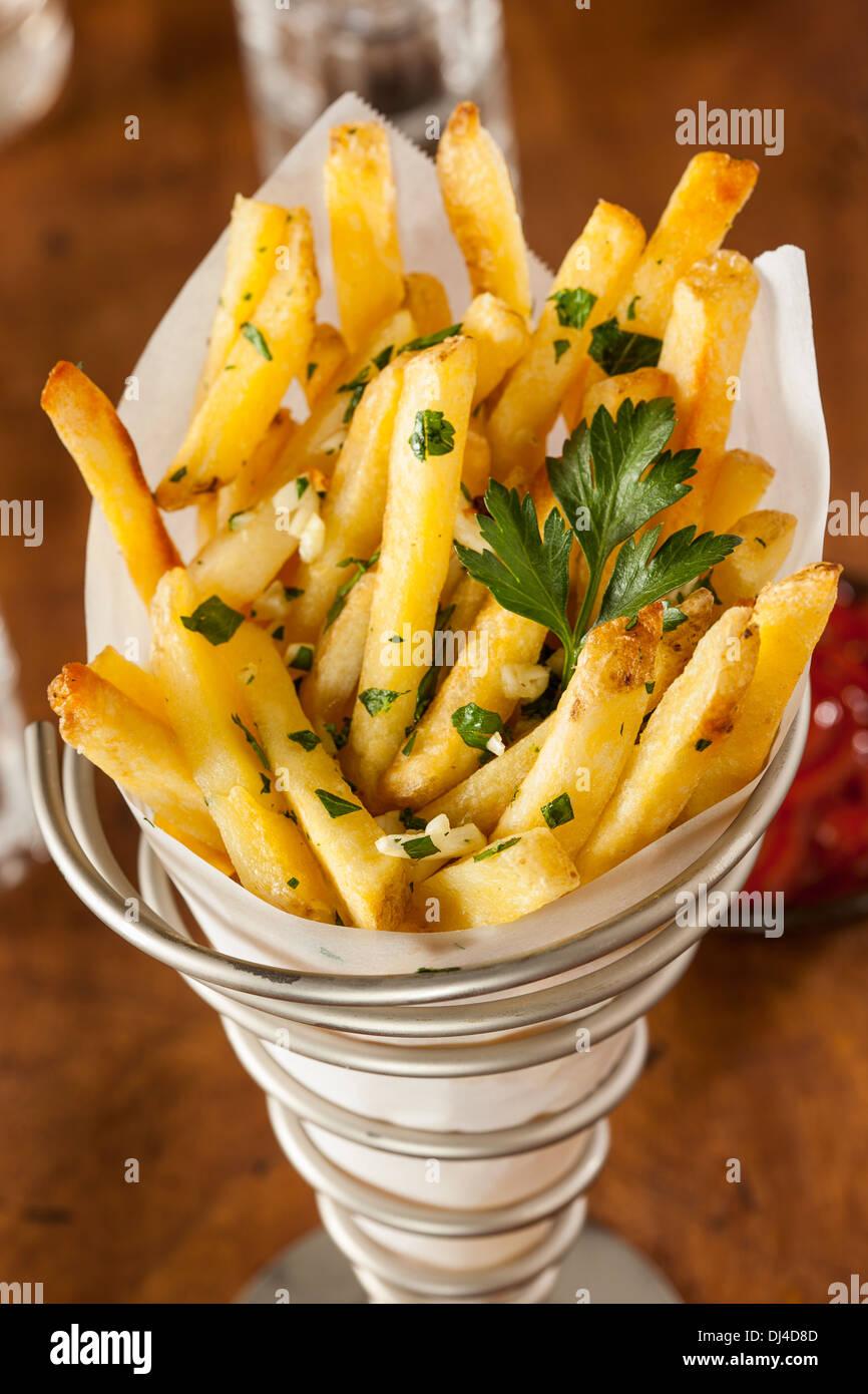 Aglio e prezzemolo e patate fritte con Ketchup Immagini Stock