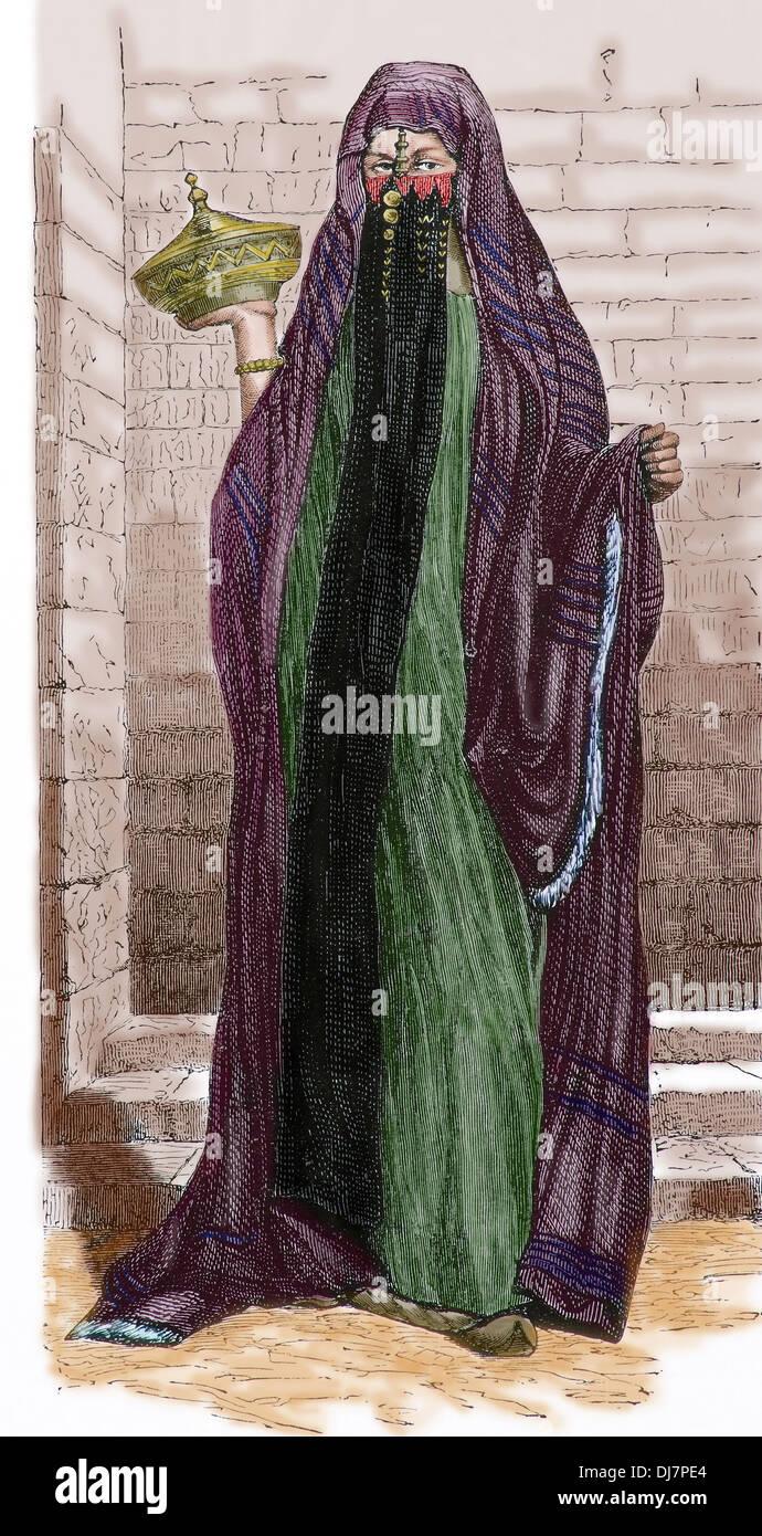 L'Africa. L'Egitto. Velò Muslism lady. Il Cairo. Incisione, 1890. Colorazione successiva. Immagini Stock
