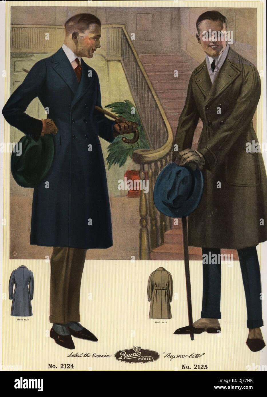 Gli uomini in doppio petto cappotti che porta canne e cappelli, indossando spats. Immagini Stock