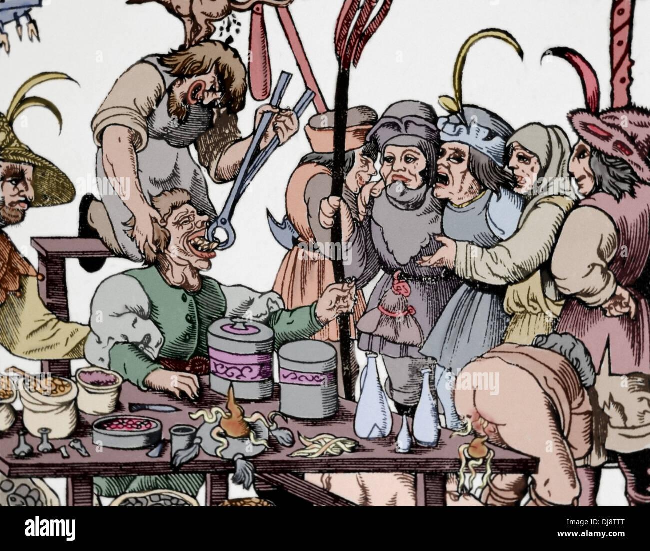 La storia della medicina. Dentista (barbieri o medici generali). Medioevo. La satira. Incisione colorata. Immagini Stock